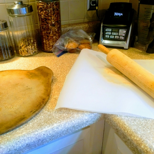 Dough between two sheets of parchment paper